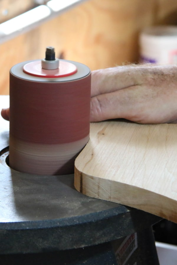 Use a wide-belt or drum sander